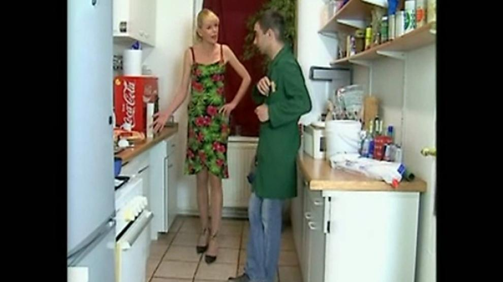 German housewife Anna Lena with the plumber in the kitchen