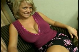 Beautiful busty blonde MILF sucks and takes two cocks in bed