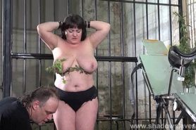 Extreme amateur bdsm of whipped and stinging nettle tortured bbw slaveslut Andrea punished in the prison cellar