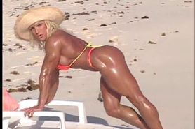 Erotic muscle MILF Peggy bares her vascular hard body at the beach