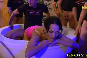 Fetish babe in group drinks piss