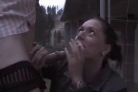 Wife gives smokey BJ outdoors