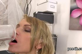 Attractive nympho is pissing and fingering shaved vulva