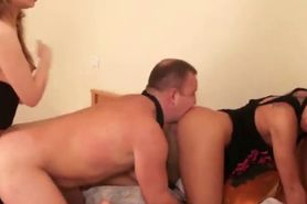 Two sluts dominate eager pussy licker on their bed