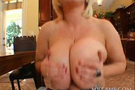 Mommy with giant boobs gives titjob and gets banged