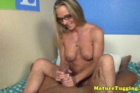 Uniform milf with pierced nipples jerking cock