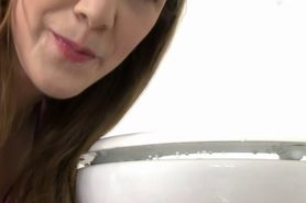 Pissing Brunette slut licking piss toilet