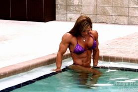 Sexy muscle babe Robin flexes her hot hard body in the pool