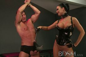 BDSM XXX Slave boy in metal stocks as he receives anal attention from his Mistress