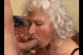 Mature grandmother giving head