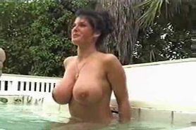 Holly Body is relaxing by the pool