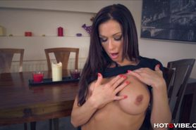 Milf fingers herself on the table