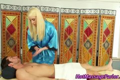 Blonde masseuse sucking cock