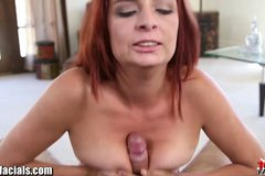 Redhead MILF with a big pussy gets a facial