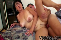 MATURE WOMAN FUCKS A YOUNG STUD !!