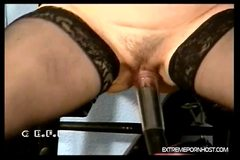 Handcuffed brunette gets her tits vacuum pumped