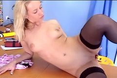 Tall leggy blonde masturbates in stockings and panties