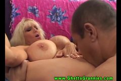 Horny blonde huge titted granny gives head