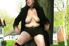 Couragious public exhibitionism and bbw flashing of speccy fatty showing pussy and teasing voyeurs outdoors