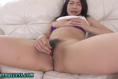 Hairy pussied asian babe toying pussy