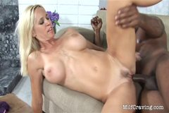 Horny black dude fucks a hot MILF on the sofa
