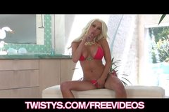 Busty blonde bikini babe plays with her new dildo