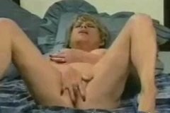 Mature Dora masturbates in her bedroom