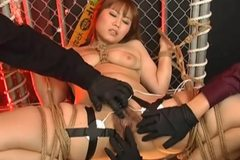 Submissive Japanese girl with big tits prodded with electric sex toys