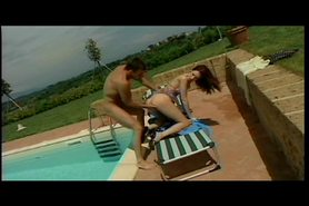 Redhead gets pussy and ass fingered on lawn chair near the pool