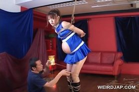 Asian pregnant sex slave gets teased in ropes
