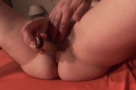 Mature hottie pinched by the nipples and toy fucked