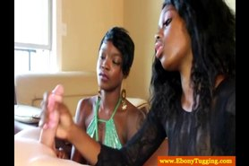 Two black ebonies jerking dick