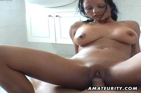 Busty amateur Milf sucks and rides in her bathroom