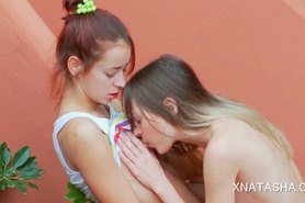 Teen lesbos Natasha Shy and Ivana rubbing cunts outdoor