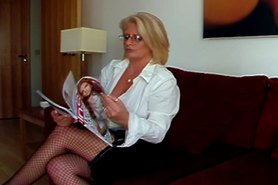Robyn Ryder hot solo in fishnets and high heel dildo
