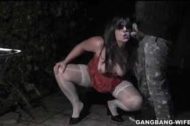 Slutwife pissed on by some guys outdoors