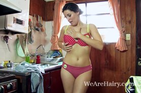 Amber strips in the kitchen and masturbates alone