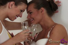 Two hot lesbians fucking each other with see through strapon