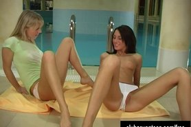 Adorable lesbians toying cunts at pool