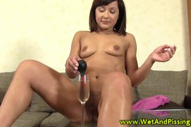 Pissdrinking slut douches her pussy with pee