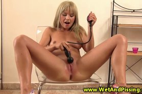 Piss wam babe expands her wet pussy with toys