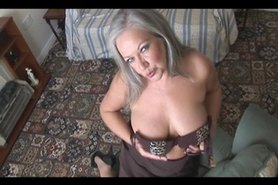 MILF Attractive busty granny in stockings stripping