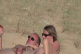 Wife and her hubby nude on the beach