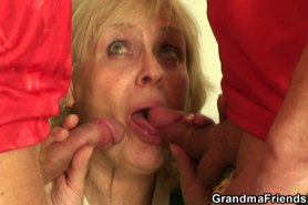 Old blonde pleasing two friends
