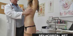 Naked pregnant woman milking