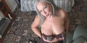 Busty granny in stockings