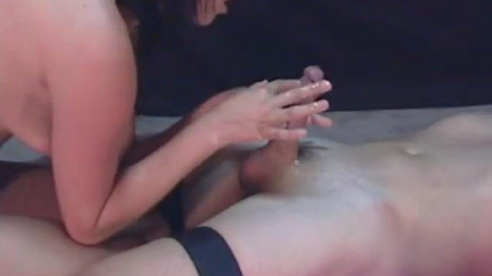 Sexy brunette makes a guy come and continues abusing his cock