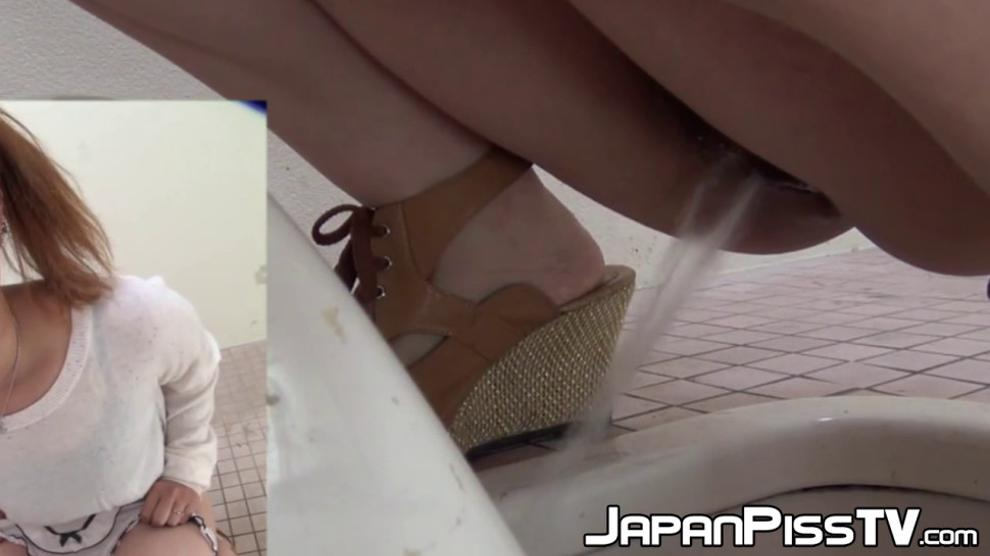 Japanese ladies taped pissing in public bathroom