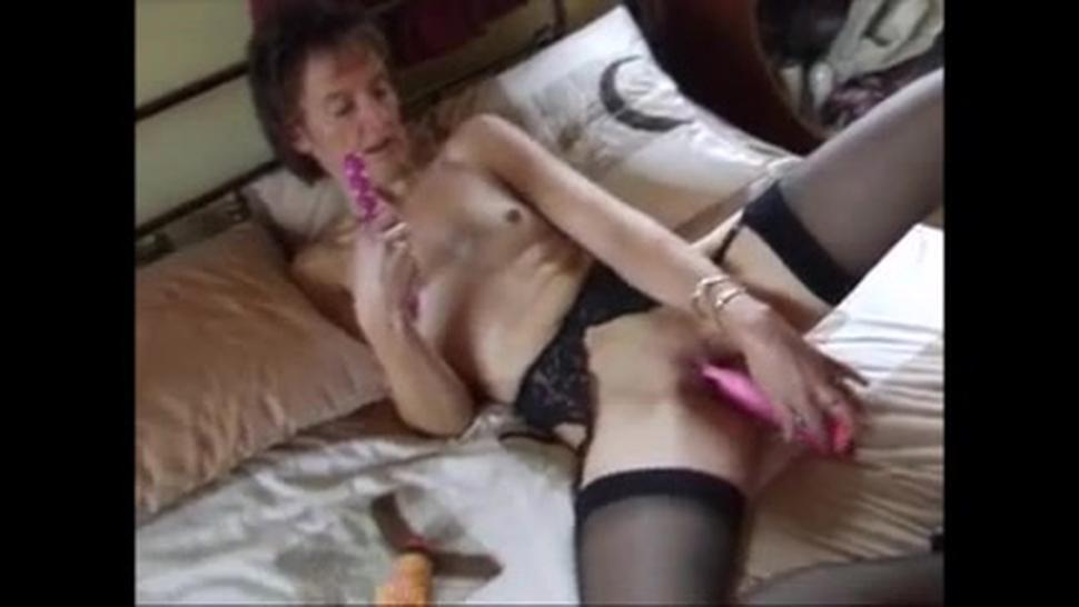 Skinny granny in lingerie masturbating with toys