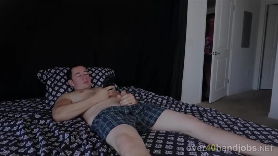 Cougar with pierced nips jerking a big fat cock
